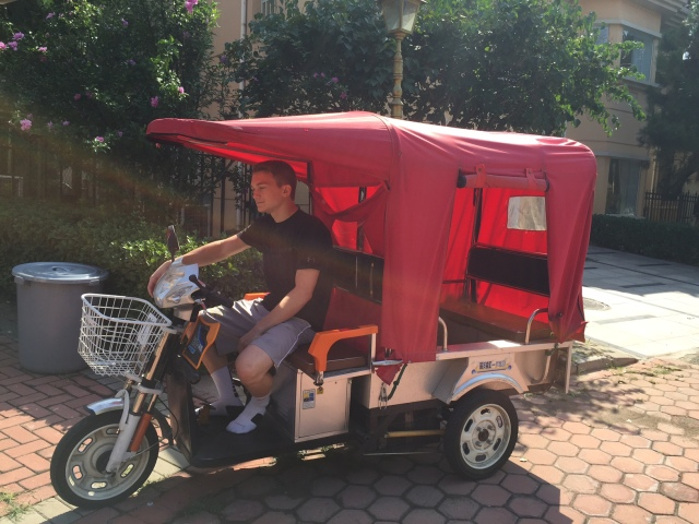 Dwight driving the borrowed tuk tuk.